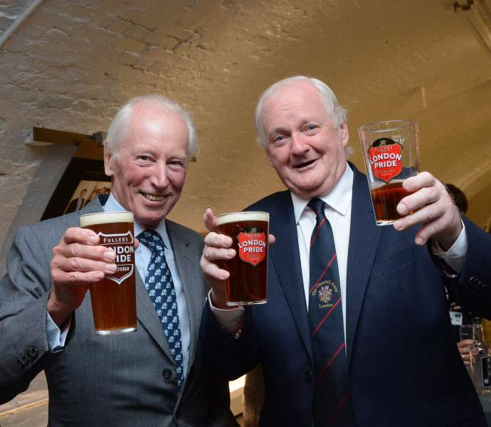 Corporate Photography London - Two businessmen holding-up pints of London Pride
