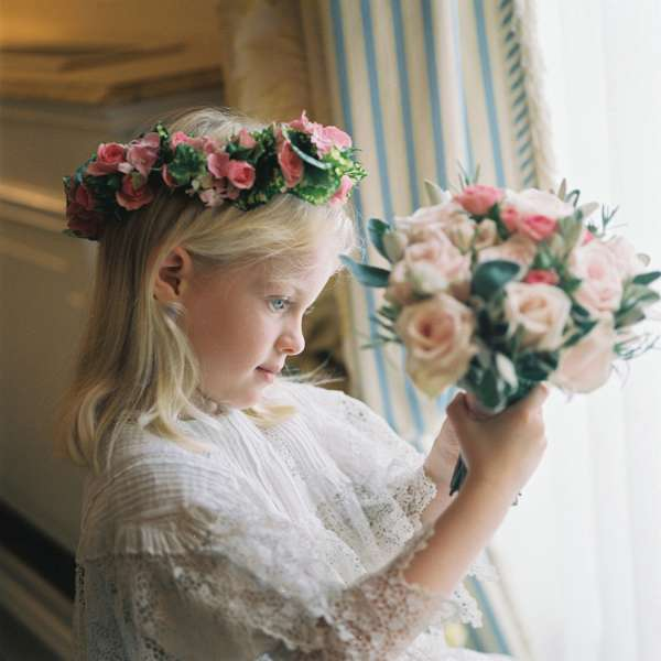Wedding Photography London - Young bridesmaid holding a bouquet