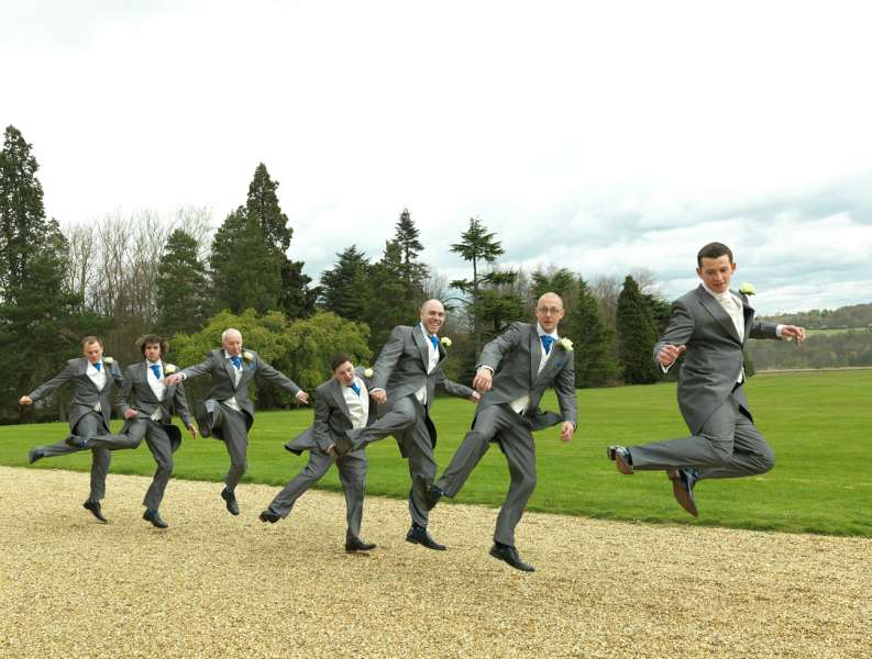 Wedding Photographers London - Groom and groomsmen jumping