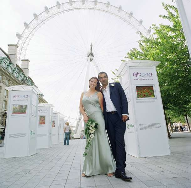 Wedding Photographers London - Bride and groom in front on the London Eye